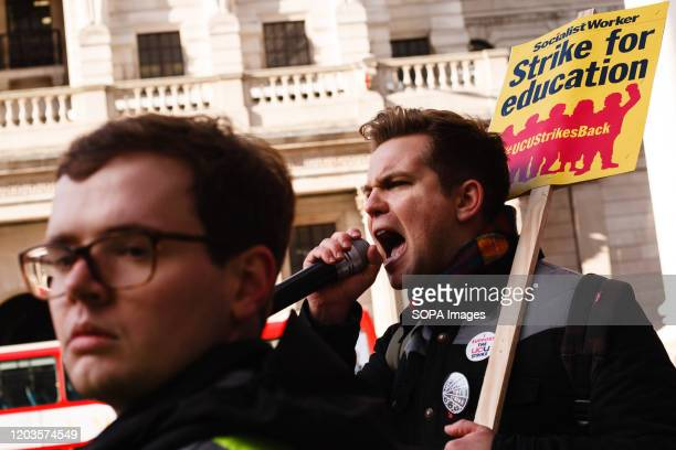 Member of University and College Union chants slogans while holding a placard during the demonstration. The UCU launched a 14-day strike on February...