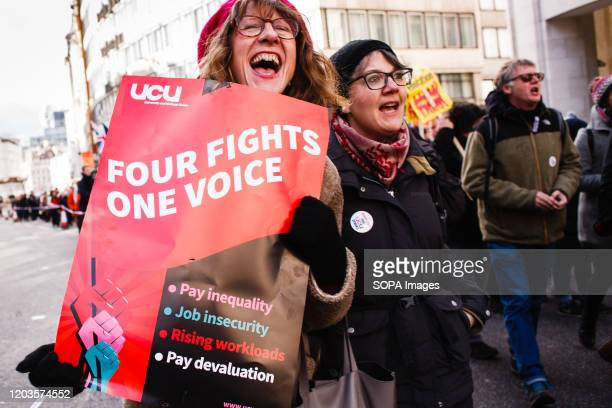 Member of University and College Union chants slogans while holding a placard that says four fights one voice during the demonstration. The UCU...