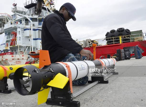 A member of US Navy Undersea Rescue Command checks gear before boarding the Skandi Patagonia vessel on the harbour of Comodoro Rivadavia Chubut on...