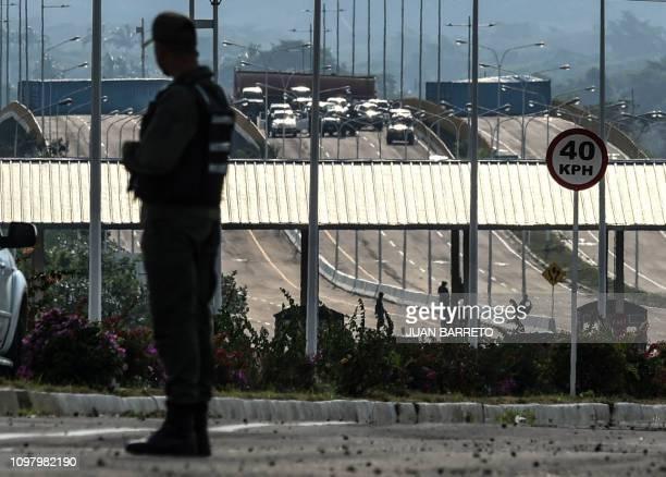 A member of Venezuela's Bolivarian National Guard patrols at Tienditas international bridge in Urena Tachira state Venezuela in the border with...