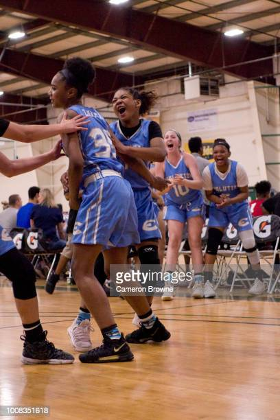A member of Washington Evolution celebrates from the bench during the game against Tree of Hope Pacific Red during the Jr NBA World Championship...
