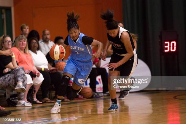 A member of Washington Evolution dribbles the ball during the game against Tree of Hope Pacific Red during the Jr NBA World Championship Northwest...