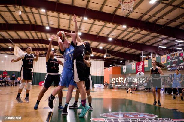 A member of Washington Evolution drives to the basket during the game against Tree of Hope Pacific Red during the Jr NBA World Championship Northwest...