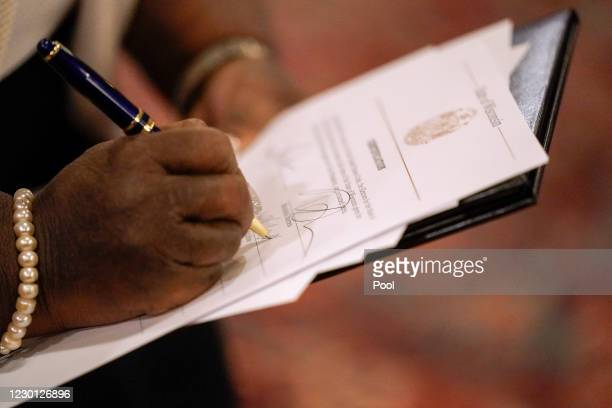Member of Wisconsin's Electoral College casts their vote for the presidential election at the state Capitol on December 14, 2020 in Madison,...