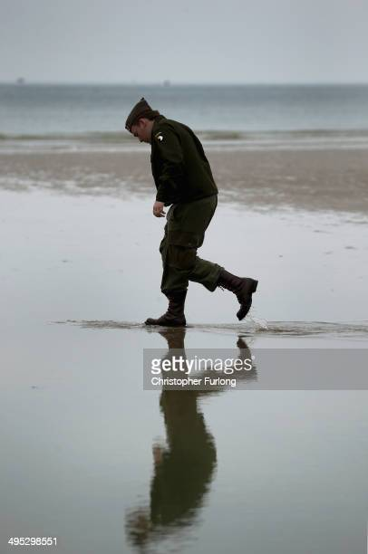 A member of WWII reenactment group walks on Gold Beach at Arromanches les bains as preparations for the 70th Anniversary Of DDay are finalised on...