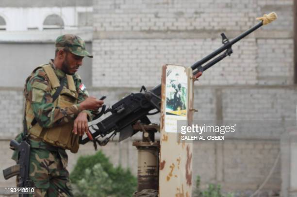 Member of Yemen's southern separatist-dominated Security Belt Forces stands guard during a meeting of the Southern Transitional Council in the...
