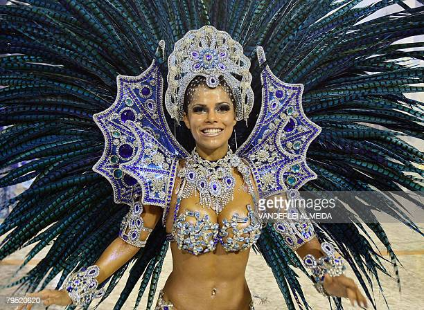 A member os Portela samba school performs at the Sambodrome during the first night of carnival celebrations in Rio de Janeiro Brazil on February 4...