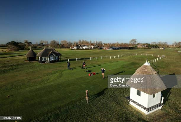 Member plays his tee shot on the first hole watched by a dog as golf returned at Royal St. George's Golf Club on March 29, 2021 in Sandwich, England....