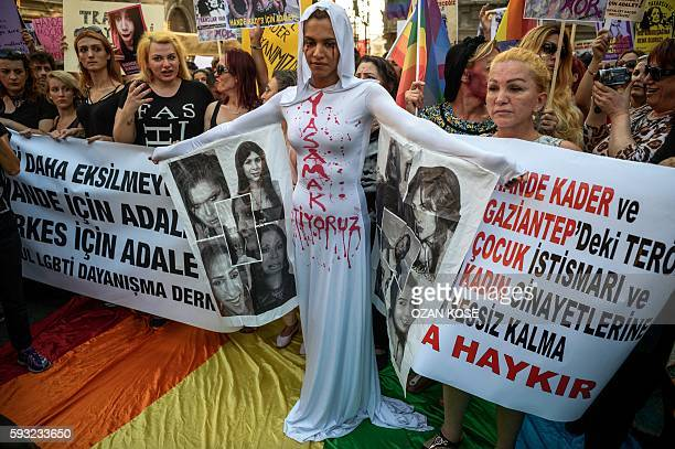"Member stands in front of a banner with make up on her face and a writing on her body ""I want to live"" on August 21, 2016 in Istanbul during a..."