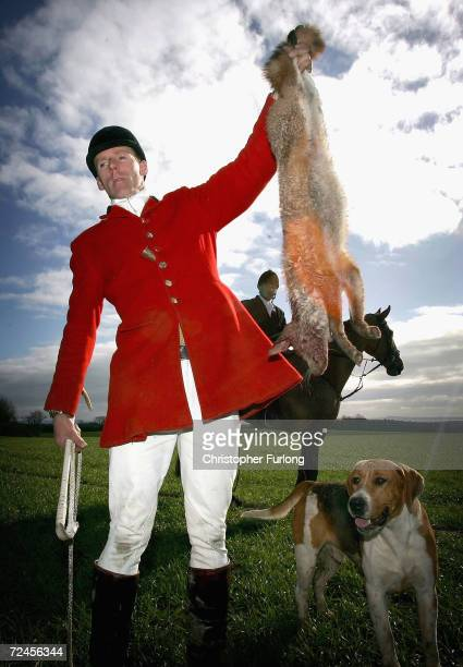 A member The South Durham Hunt shows off a fox which was shot after being flushed out by two blood hounds on the first day of the enforcement of the...