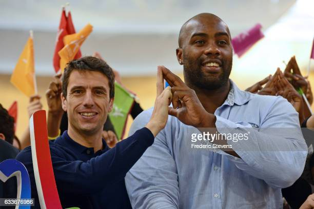 IOC member Tony Estanguet and Teddy Riner pose during the visit of Dora Maar college on February 3 2017 in Paris France In order to support the...