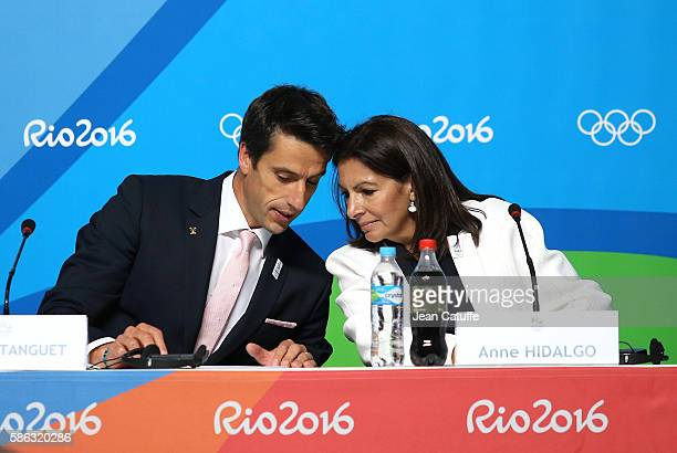 IOC member Tony Estanguet talks to Mayor of Paris Anne Hidalgo during a press conference given by the Paris 2024 Candidate Olympic City delegation at...
