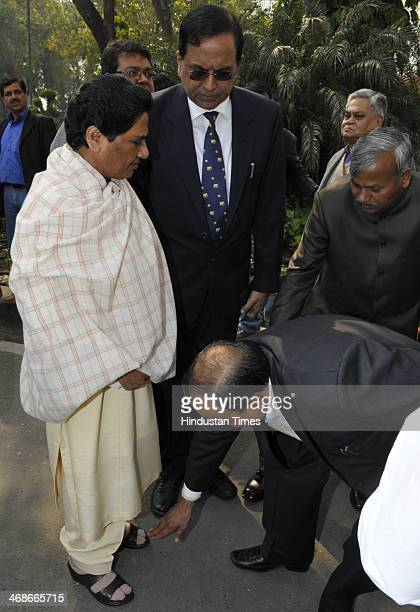BSP member touches feet of Bahujan Samaj Party Chief Mayawati as she arrives to attend Parliament during the extended winter session on February 11...