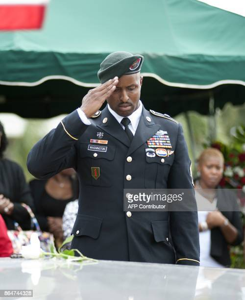 A member US Army Special Forces salutes the casket of US Army Sgt La David Johnson at his burial service in the Memorial Gardens East cemetery on...