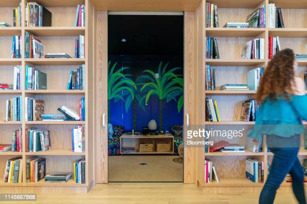 Member walks by a play room at the WeWork Cos Inc. 85 Broad Street offices in the Manhattan borough of New York, U.S., on Wednesday, May 22, 2019....