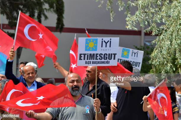 A member waves a Turkish flag during a rally in support of Meral Aksener presidential candidate and the leader of the opposition IYI Party in Ankara...