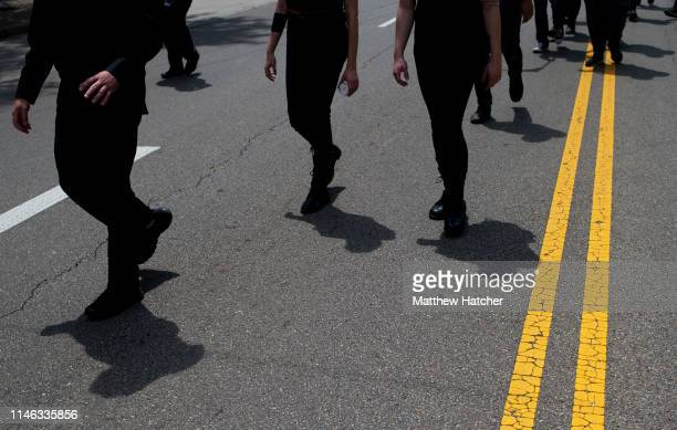 Members affiliated with Black Block head in formation to counter protest a rally held by the KKK affiliated group Honorable Sacred Knights of Indiana...