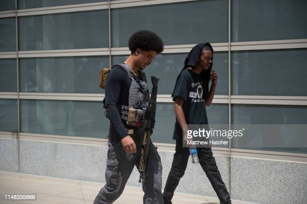 Members affiliated with the New Black Panther Party make their way to Courthouse Square to counterprotest a rally held by the KKK affiliated group...