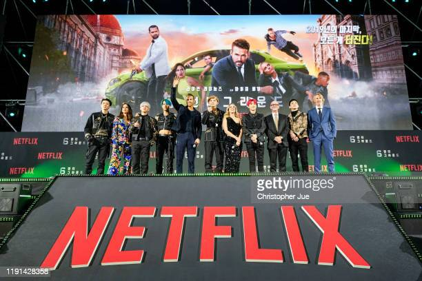 Members and 6 Underground cast attend the world premiere of Netflix's '6 Underground' at Dongdaemun Design Plaza on December 02, 2019 in Seoul, South...