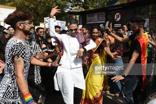 Members and activist the Lesbian Gay Bisexual Transgender Queer Intersex and Allies communities dance during the 'Ahmedabad Queer Pride 2019' in...