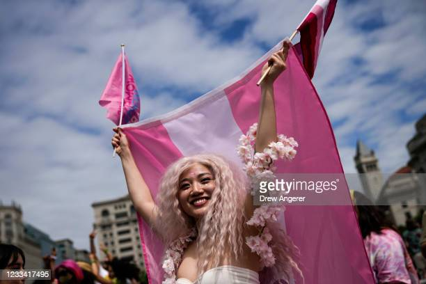 Members and allies of the LGBTQ community dance and celebrate at the end of the Pride Walk and Rally in Freedom Plaza on June 12, 2021 in Washington,...