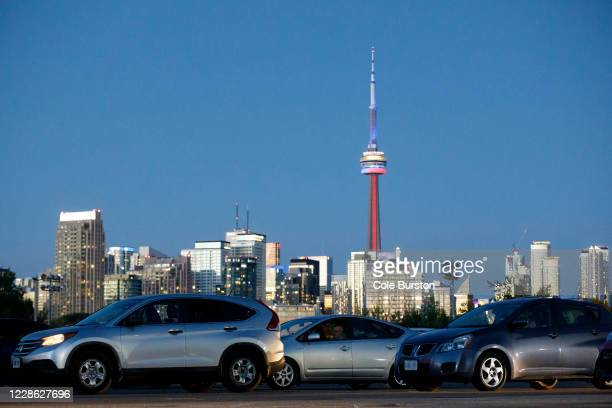 Members and guests of the City Shul congregation take part in a Rosh Hashanah celebration at a drive-in on September 20, 2020 in Toronto, Canada.To...