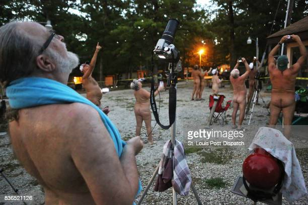 Members and guests of the Forty Acre Club a nudist club near Lonedell took pictures of the eclipse as it neared totality Three hundred and fifty four...