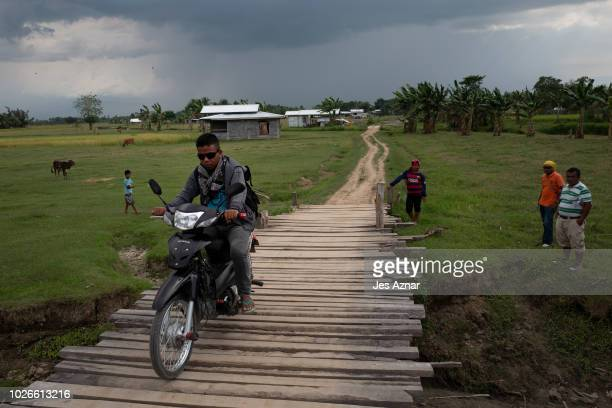 MILF members and residents use a dirt road and dilapidated bridges on August 23 2018 in Mamasapano Maguindanao southern Philippines Decades of heavy...
