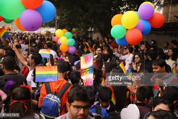 LGBT members and supporters many wearing colorful costumes and holding balloons participate in the Delhi's 10th Queer Pride March from Barakhamba...
