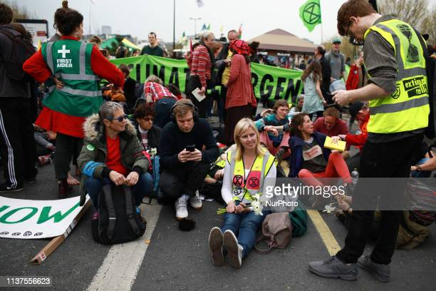 Members and supporters of climate change activist group Extinction Rebellion block Waterloo Bridge in London England on April 16 2019 Demonstrations...