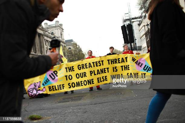 Members and supporters of climate change activist group Extinction Rebellion block Parliament Street in London England on April 16 2019...