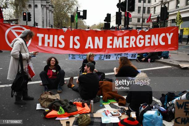 Members and supporters of climate change activist group Extinction Rebellion block the Marble Arch end of Oxford Street in London England on April 16...