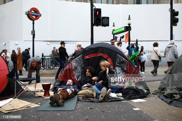 Members and supporters of climate change activist group Extinction Rebellion block Oxford Circus in London England on April 16 2019 Demonstrations...