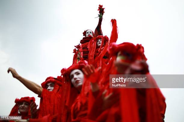 Members and supporters of climate change activist group Extinction Rebellion demonstrate on Waterloo Bridge in London England on April 16 2019...