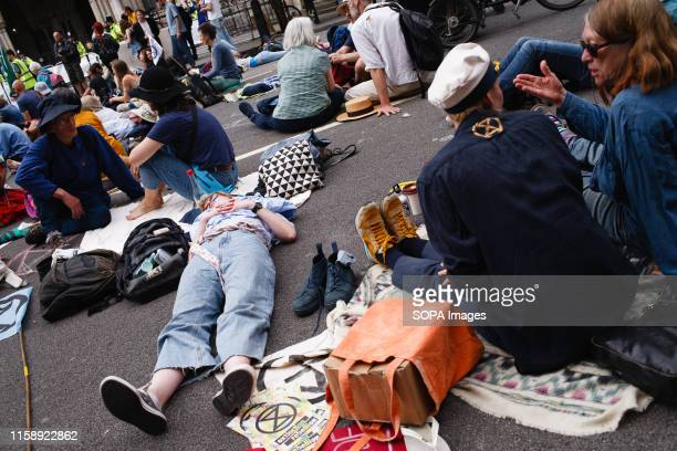 Members and supporters of climate change activist group Extinction Rebellion take part in the opening day of the group's 'Summer Uprising'...