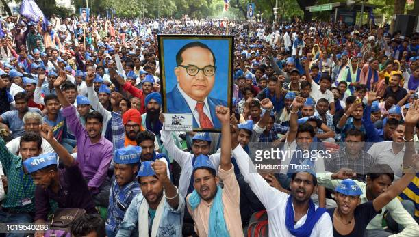 Bhim Army president Vinay Ratan Singh with others during the protest at Parliament Street to voice their dissent against the arrest of Dalit...