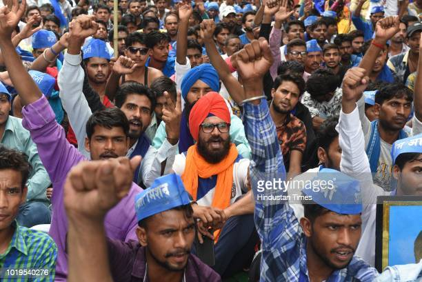 Members and supporters of Dalit outfit Bhim Army stage a protest Bahujan Sankalp Mahasabha at Parliament Street to voice their dissent against the...