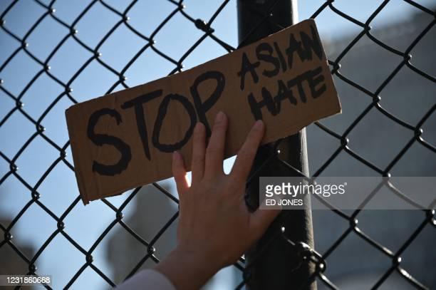 """Members and supporters of the Asian-American community attend a """"rally against hate"""" at Columbus Park in New York City on March 21, 2021. - Three..."""