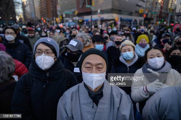 Members and supporters of the Asian-American community gather during a 'peace vigil' for victims of Asian attacks, at Union square in New York city...