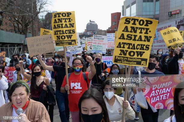 Members and supporters of the Asian-American community take part on the nationwide day of protests against anti-Asian violence in the Queens borough...