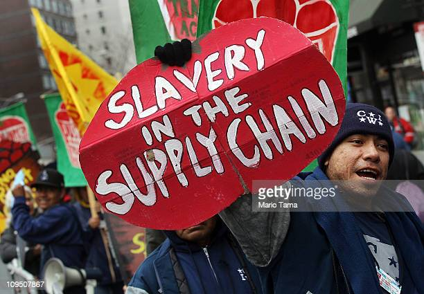 Members and supporters of the Coalition of Immokalee Workers protest outside a Trader Joe's store in Manhattan February 28 2011 in New York City The...