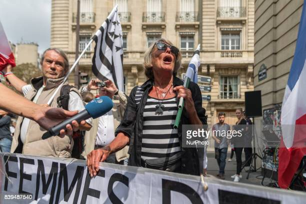 Members and supporters of the collective quotMilitary spouses are angryquot hold flags and a banner during a demonstration to protest notably against...
