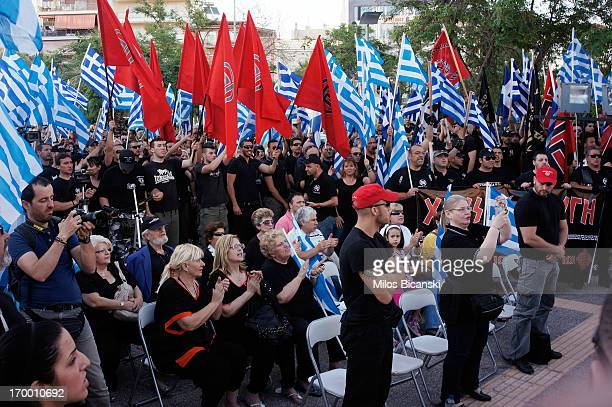 Members and supporters of the extremeright Golden Dawn party attend a gathering on May 26 2013 in Athens Greece The far right movement Golden Dawn...