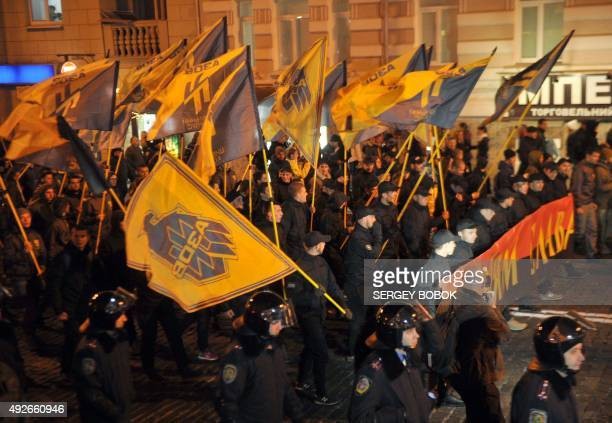 Members and supporters of the far-right Ukrainian volunteer battalion Azov march in Kharkiv on October 14 to mark Ukrainian Defender's Day and the...