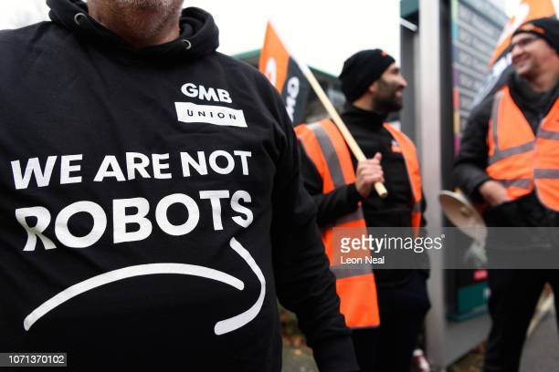 Members and supporters of the GMB union protest outside the Amazon offices as the company holds it's annual Black Friday sales, on November 23, 2018...