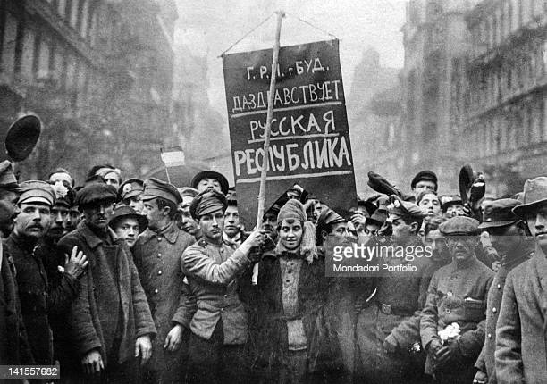 Members and supporters of the Hungarian Communist Party participating in a demonstration during the 'Two Red Years' raising a placard praising Russia...