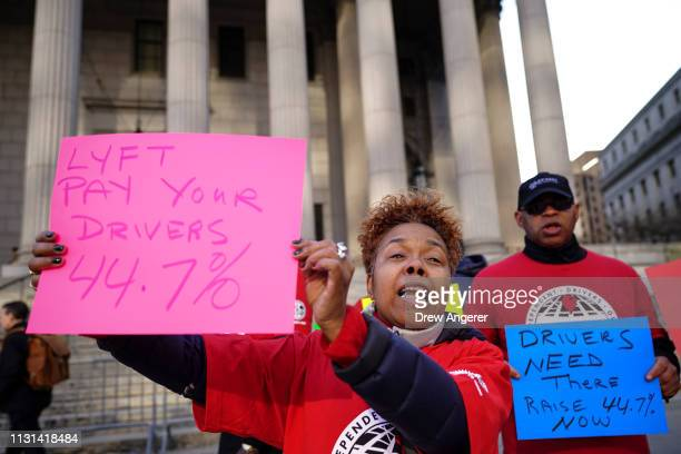 Members and supporters of the Independent Drivers Guild protest against Lyft which is challenging the way the Taxi and Limousine Commission...
