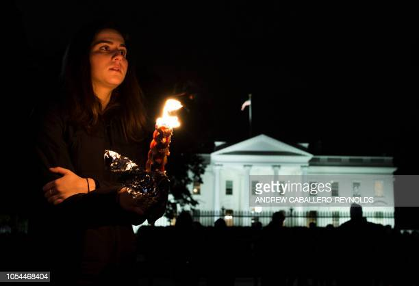 Members and supporters of the Jewish community come together for a candlelight vigil in remembrance of those who died earlier in the day during a...