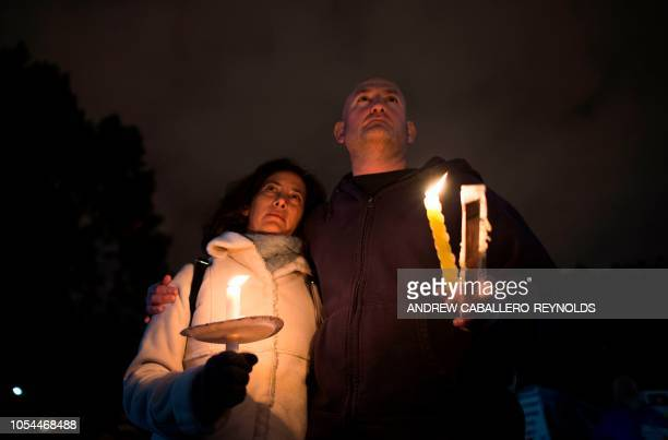 Members and supporters of the Jewish community come together for a candlelight vigil, in remembrance of those who died earlier in the day during a...