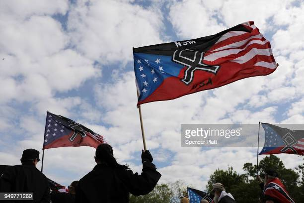 Members and supporters of the National Socialist Movement one of the largest neoNazi groups in the US hold a rally on April 21 2018 in Newnan Georgia...